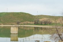 A Small Lake On A Background O...