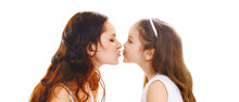 Happy Mothers Day, Birthday Concept - Daughter Kissing Her Mother On White Background