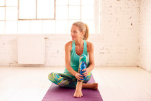 Beautiful Middle Aged Woman Drinking Water And Relaxing After Workout