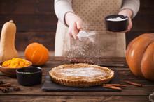Woman Cooks Pumpkin Pie