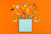 Blank Notebook And School Supplies. Creative Flat Lay Desk