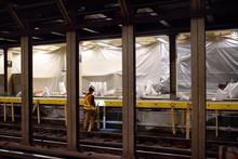 NEW YORK, USA - OCTOBER 22, 2018: Repair In New York Subway. MTA Worker Repairing The Platform Of The NYC Subway Station