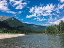 Rafting The Flathead River In Glacier National Park In Montana During Summer