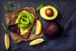 Leinwandbild Motiv Sandwiches with rye bread and fresh sliced avocado