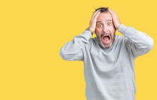 Handsome Middle Age Senior Man Wearing A Sweatshirt Over Isolated Background Crazy And Scared With Hands On Head, Afraid And Surprised Of Shock With Open Mouth