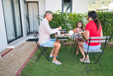 Happy family making breakfast outdoor - 266816296