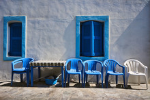 Table And Chairs In Front Of A Greek House On The Island Of Nisiros.
