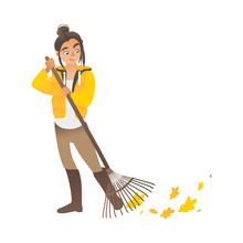 A Cute Girl Or Young Woman Sweeps The Leaves With A Rake.