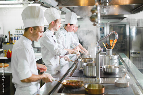 cook cooks in a restaurant. Fototapeta
