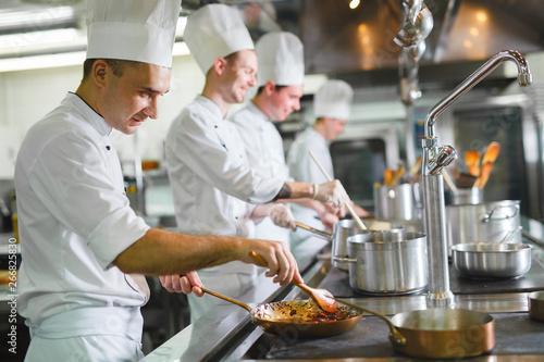 Fototapeta cook cooks in a restaurant. obraz
