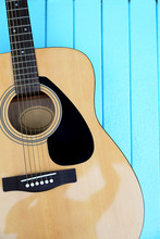Top View Of Guitar On Wooden Blue Background. Summer Holiday Or Music Concept.