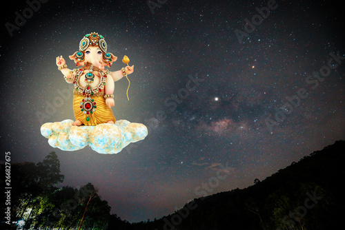 Lord Ganesha on cloud stone with Milky Way sky background Canvas Print