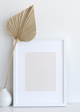 Picture Frame On Shelf With Palm Fan Decor - Mock-Up For Print/Poster/Graphic Design. Blank And Empty Frame - 8x10, 12x16 Inches Or Similar Ratio
