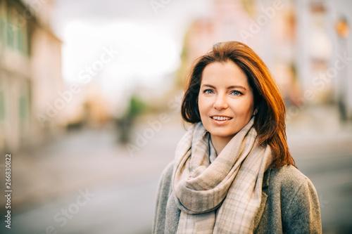 Fotografie, Obraz Outdoor portrait of beautiful woman wearing grey coat