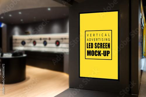 Mock up vertical LED screen at entrance IT Shop
