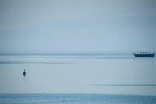 Fishing Boat Out On The Sea Of Galille On A Hazy Morning, Barely Visible