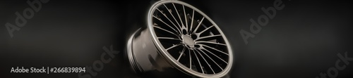 Fotografía  new Luxury Black alloy Wheel, sporty with thin spokes, panorama copy cpace on bl