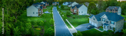 Cuadros en Lienzo Aerial panorama of modern upper middle class single family homes neighborhood st