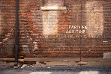 """Brick Wall """"No Parking"""" Paint"""