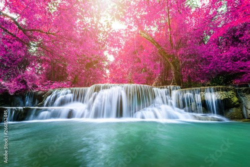 Foto auf Leinwand Rosa Lovey Amazing in nature, beautiful waterfall at colorful autumn forest in fall season
