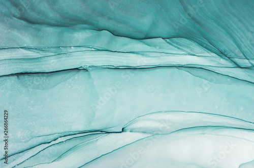 Alcohol ink. Style incorporates the swirls of marble or the ripples of agate.  Abstract painting, can be used as a trendy background for wallpapers, posters, cards, invitations, websites.