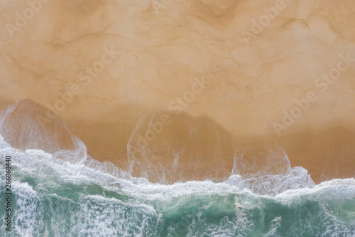 Atlantic ocean sandy beach with turquoise ocean and waves. Aerial view
