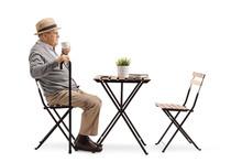 Senior Man Drinking Coffee At ...