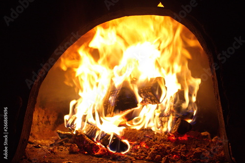 Hot yellow fire in the stove