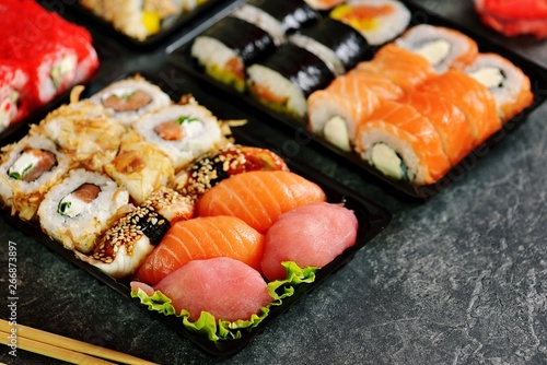 Poster Sushi bar Sushi set with salmon, soft cheese, tuna, smoked eel. Sushi delivery to home. Healthy food.