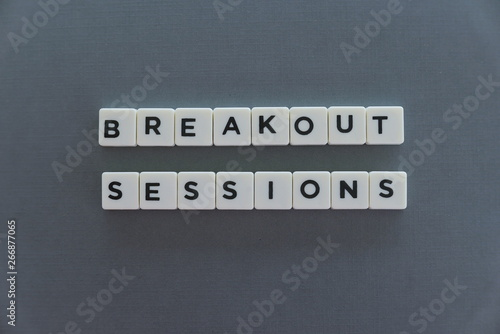 Foto Breakout Sessions word made of square letter word on grey background