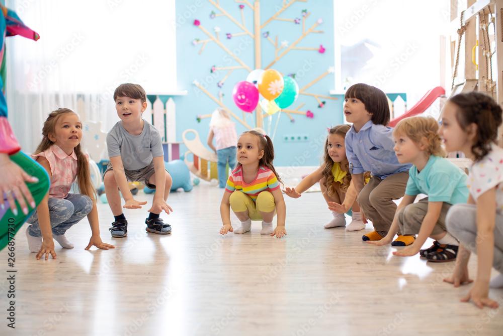 Fototapety, obrazy: Cute children kids boys and girls squat playing roundelay