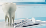 3D render of human tooth and dental equipment in consulting room.