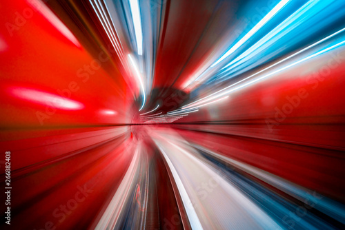 Photo sur Aluminium Autoroute nuit Abstract colorful concentric light trail accelerating through a tunnel.