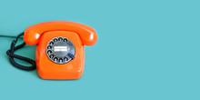 Retro Phone Orange Color, Vintage Handset Receiver On Green Background. Copy Space.