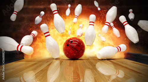 Fotografia  Bowling strike hit with fire explosion