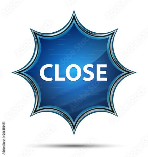 Photo Close magical glassy sunburst blue button