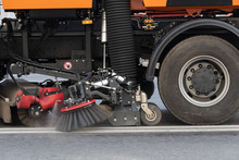 Street Sweeper Nozzles And Brushes Close-up While Driving