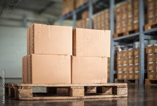 Fototapeta unlabelled boxes on pallet in a warehouse obraz