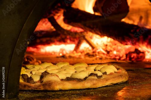 Italian pizza inside a wood oven