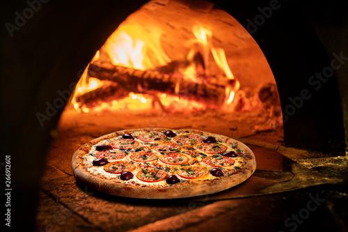 Fototapeta Image of a brick pizza oven with fire obraz