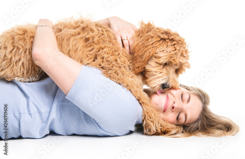 woman with his Golden Labradoodle dog isolated on white background Wallpaper Mural