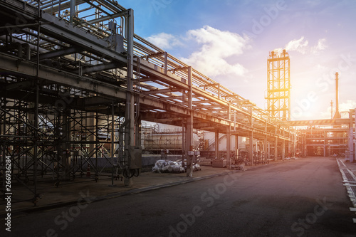 Fotografie, Obraz Pipeline and pipe rack of petroleum industrial plant with sunset sky background