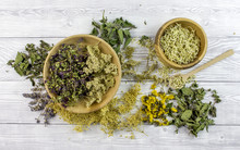 Dried Different Herbs On Wooden Background