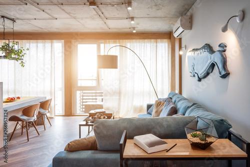 Fototapeta  Minimalist modern living room with sofa in loft style flat