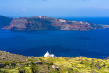 Traditional Whitewashed Greek Church On The Hill Near Oia Overlooking Aegean Sea, Santorini, Greece
