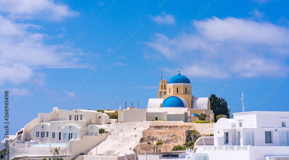 Fototapety, obrazy: Santorini landscape with view of Agios Georgios Church and whitewashed houses in Oia, Greece