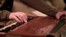 Closeup Detail Of Hands Playing Accordion Instrument. Clip. Detail Of Fingers Playing The Accordion With Buttons. Playing Classical Accordion Closeup