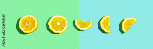 Fresh lemon pattern on a bright color background flat lay - 266963865