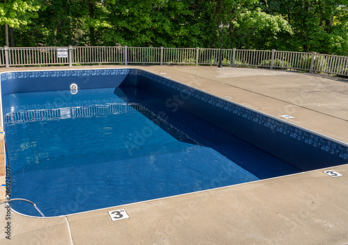 In ground swimming poolwith new vinyl liner being refilled with water ready for Fototapeta