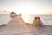 Couple Kissing At Sunset On A Wooden Pier In Cayo Guillermo, Cuba
